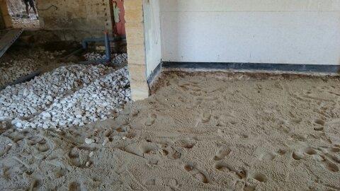Herisson et lit de sable en sous couche de dalle