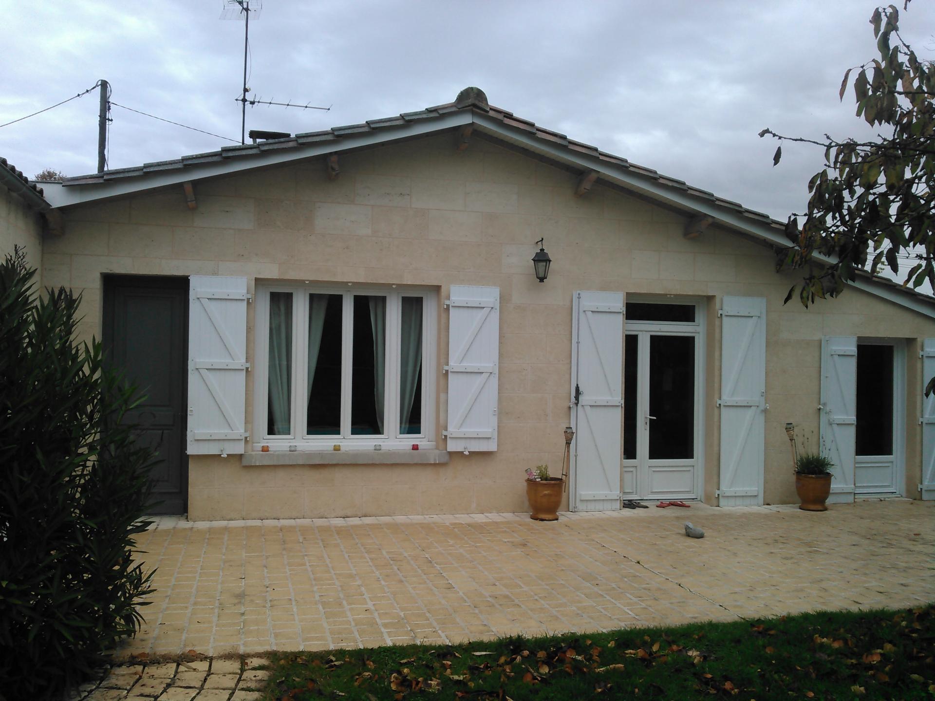 Fa ade en parements de pierre coll for Habillage facade pierre